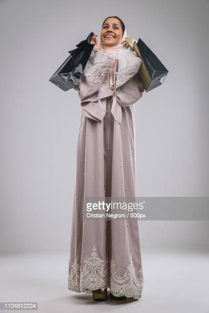 beautiful middle eastern woman wearing abaya - showing respect stock pictures, royalty-free photos & images