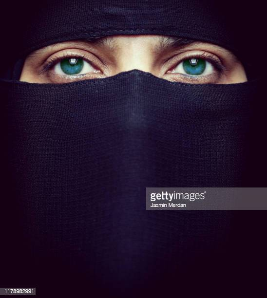 beautiful middle eastern woman with covered face - burka stock-fotos und bilder