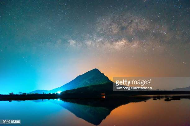 Beautiful milky way at night of many star over mountain and lake