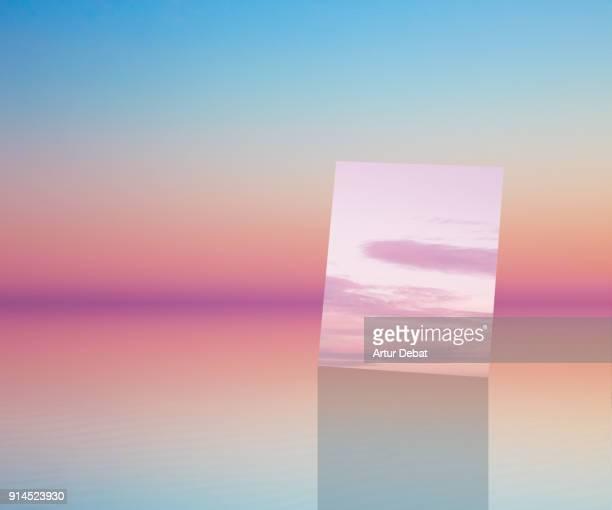 beautiful minimalist art landscape with mirror and sunset reflected. - geometriestunde stock-fotos und bilder