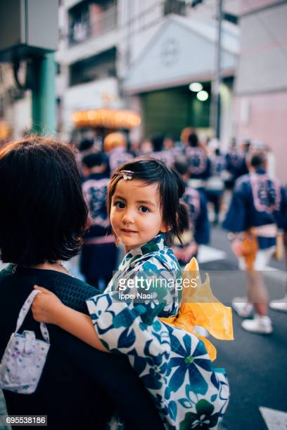 Beautiful mixed race little girl in yukata with her mother