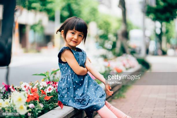 Beautiful mixed race little girl smiling at camera