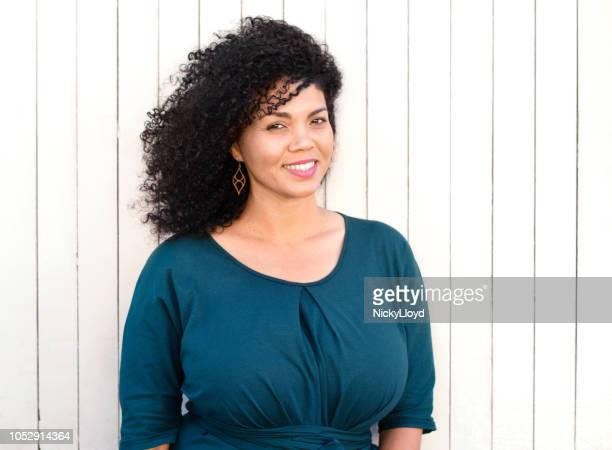beautiful mixed race woman striking a pose - curvy african women stock pictures, royalty-free photos & images