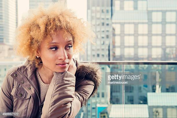 "beautiful mixed race woman with warm clothes on roof top. - ""martine doucet"" or martinedoucet stockfoto's en -beelden"