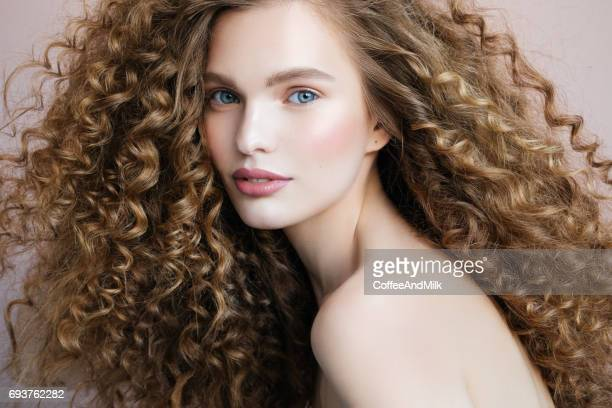 beautiful model - curly stock pictures, royalty-free photos & images