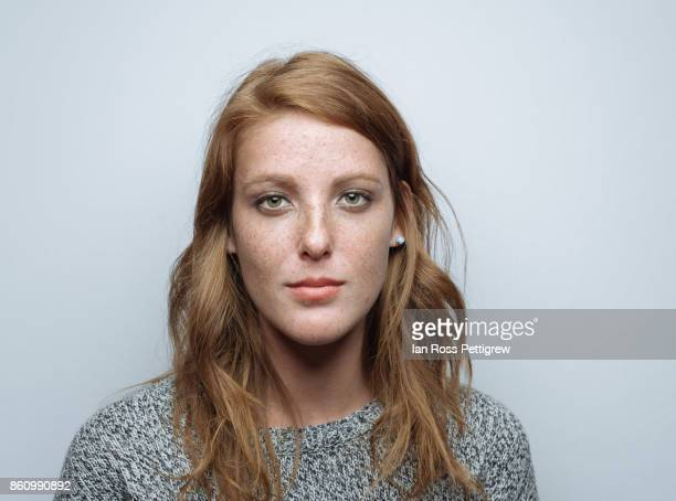 beautiful model with freckles - serious stock pictures, royalty-free photos & images