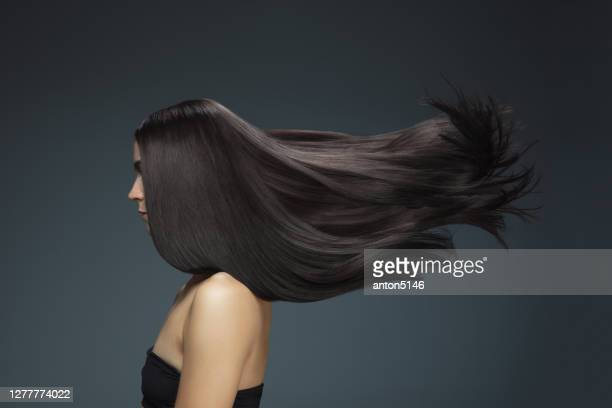beautiful model with long smooth, flying brunette hair - fashion model stock pictures, royalty-free photos & images