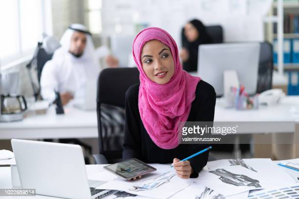 beautiful modern muslim businesswoman portrait in office - saudi arabia stock photos and pictures