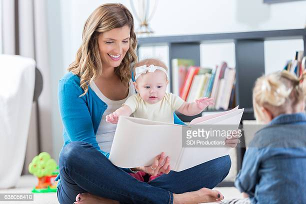 Beautiful mom reads to daughters