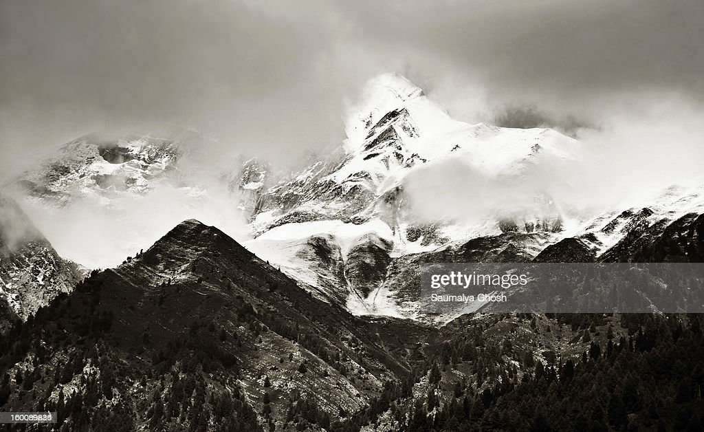 CONTENT] A beautiful monochrome view of the Himalayan mountain range at Sonmarg valley in a dark cloudy weather.