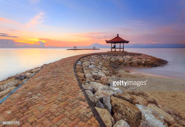 beautiful morning at karang beach, sanur in bali, indonesia - association of southeast asian nations stock pictures, royalty-free photos & images