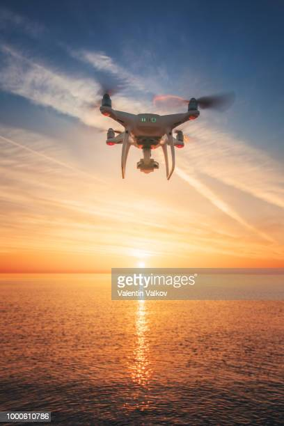 beautiful morning over the sea and flying drone - hovering stock pictures, royalty-free photos & images
