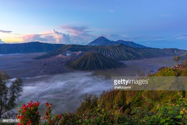 Beautiful morning view of active volcano crater with smoke at Mt. Bromo, East Java, Indonesia.