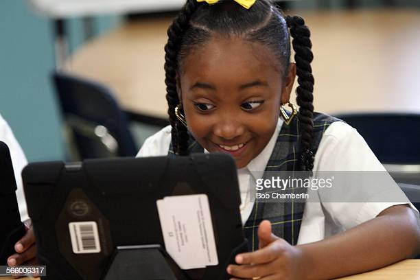 Beautiful Morris gives a big smile as she explores the possibilities with her new LAUSD provided iPad at Broadacres Elementary School in Carson on...