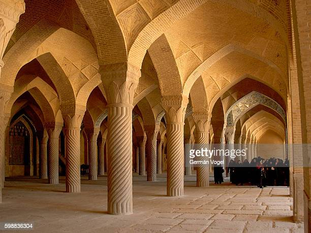 beautiful mosque colonnade hallway - shiraz vakil mosque, iran - shiraz fotografías e imágenes de stock