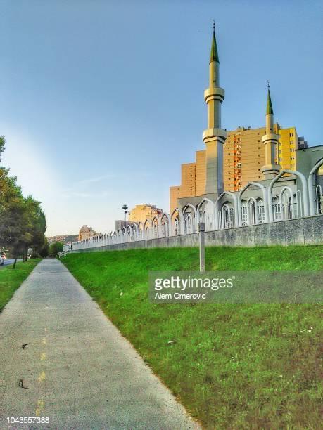 beautiful mosque with two minaret towers at urban area. - moschee stock-fotos und bilder