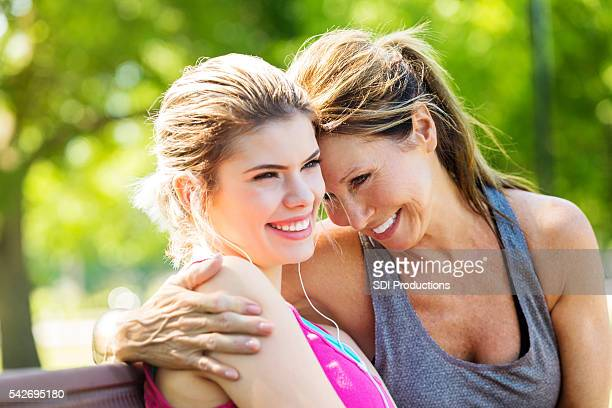 Beautiful mother and daughter embracing and smiling together