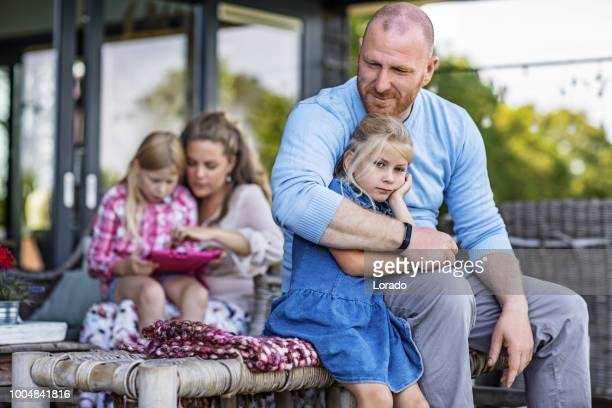 beautiful mother, handsome father and two young blonde daughters enjoying family life in their house - dutch culture stock pictures, royalty-free photos & images
