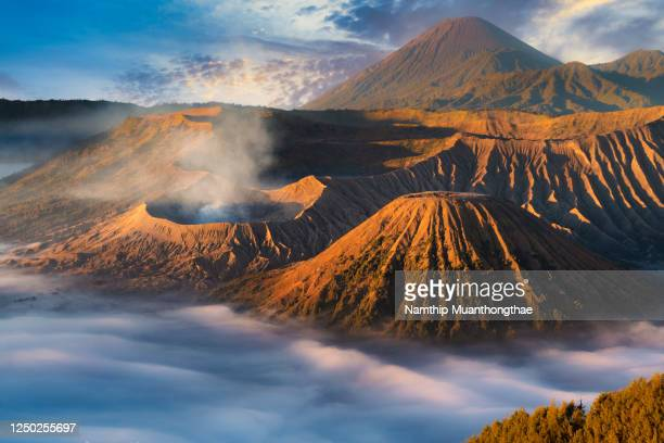 beautiful mount bromo located in indonesia in the morning time that shows the beautiful tourist attraction for creating a mountain background. - mt bromo stock pictures, royalty-free photos & images