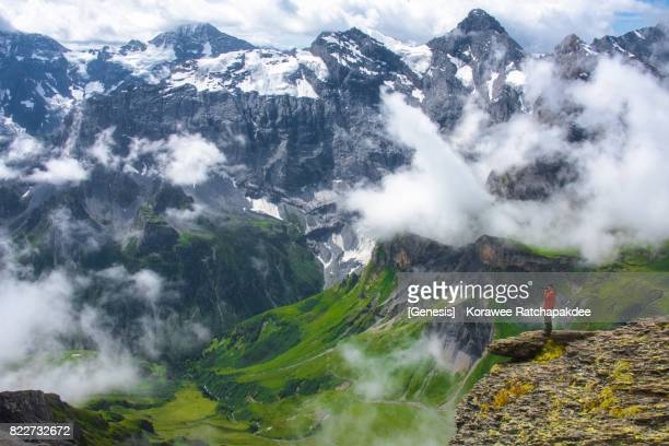 A beautiful mountain of Swiss Alps with the tourist in the frame
