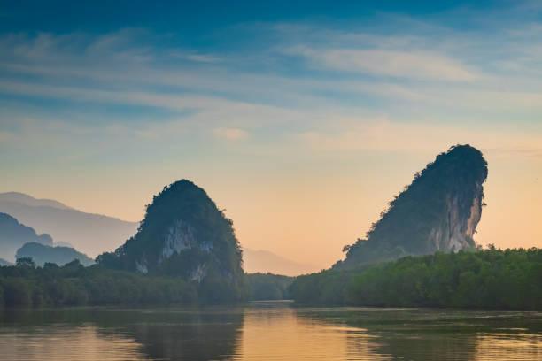 Beautiful mountain sunrise at tropical sea in south thailand.