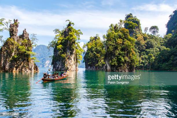 beautiful mountains lake river sky and natural attractions in ratchaprapha dam at khao sok national park - thailand stock-fotos und bilder
