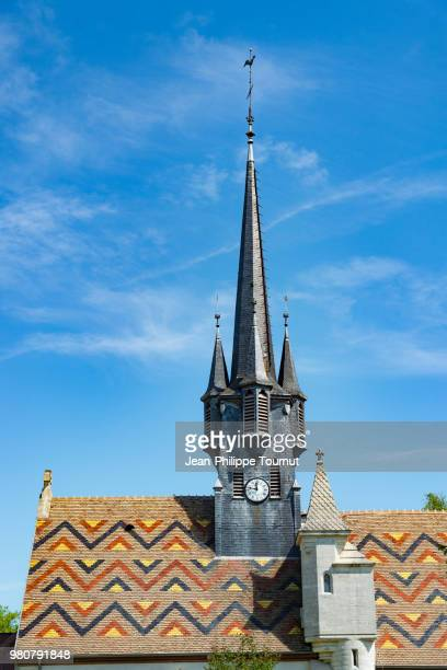 Beautiful multi-colored roof and traditionnal slate tiles clock tower of the village Church of Ruffey-lès-Beaune, Église Saint-Léger, near Beaune, Bourgogne, France