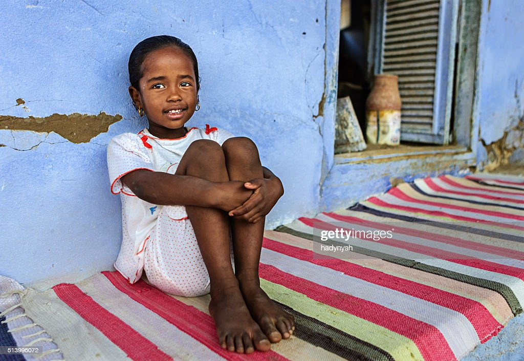 Beautiful Muslim girl resting in her house, Southern Egypt : Stock Photo