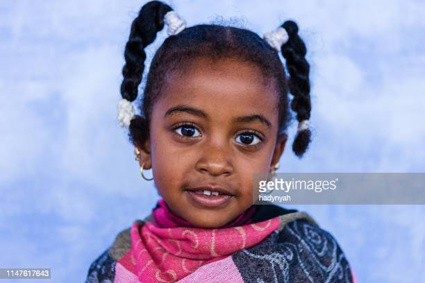beautiful muslim little girl in southern egypt - north africa stock pictures, royalty-free photos & images