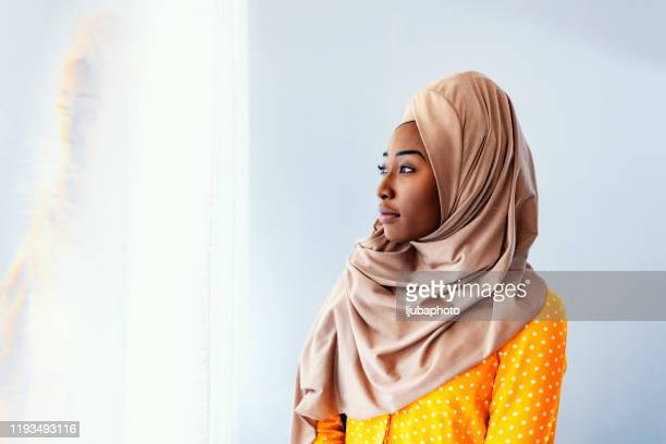 beautiful muslim woman looking away - profile stock pictures, royalty-free photos & images