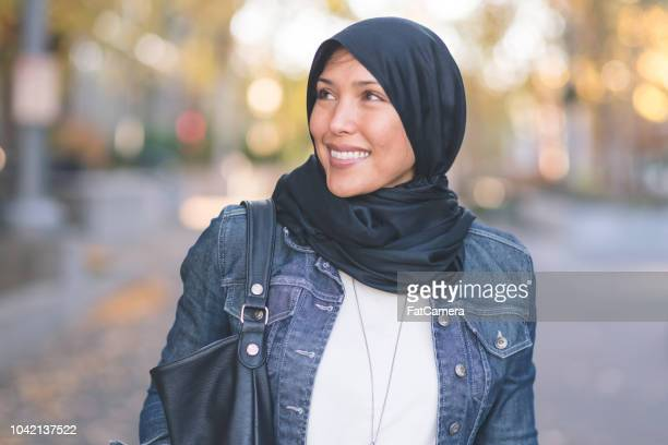 Beautiful Muslim woman walking through the city