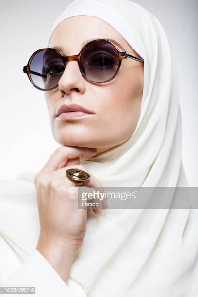 beautiful muslim woman wearing hijab - humility stock pictures, royalty-free photos & images