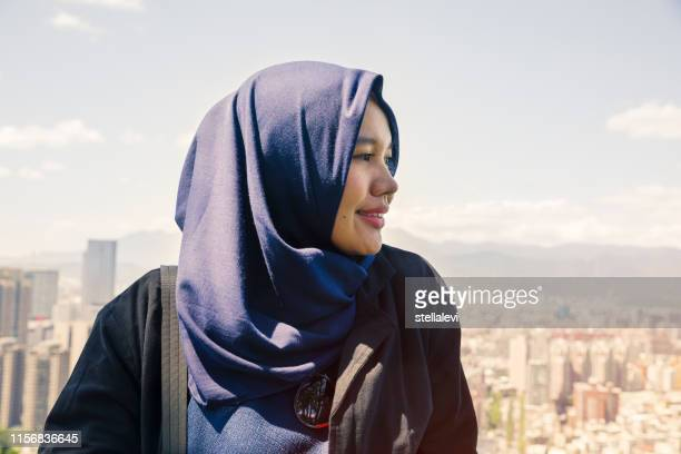 beautiful muslim young woman portrait with city view of taipei - stellalevi stock pictures, royalty-free photos & images