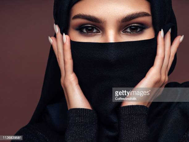 beautiful mysterious woman - niqab stock pictures, royalty-free photos & images