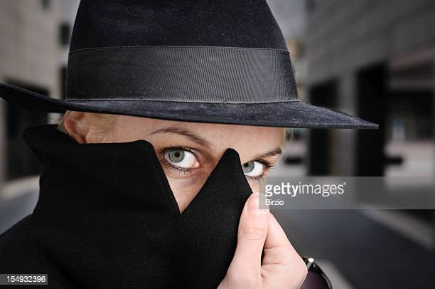 Beautiful Mysterious Woman wearing Hat and Coat