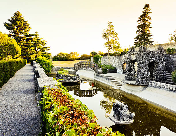 Beautiful mystery old garden with pond at sunset