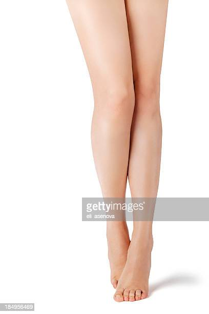 Beautiful naked female legs at white background.