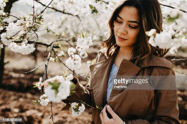 Beautiful natural young woman in the garden
