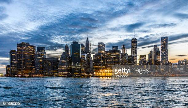 beautiful new york city skyline at sunset - wall street lower manhattan stock pictures, royalty-free photos & images