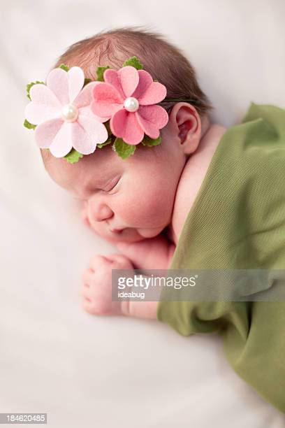 Beautiful Newborn Baby Girl Swaddled in Soft, Green Blanket