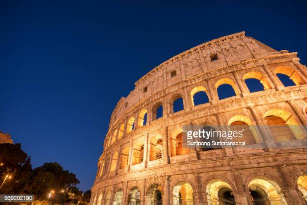 Beautiful night view of Colosseum in Rome, Italy. Rome architecture and landmark. Rome Colosseum is one of the main attractions of Rome and Italy