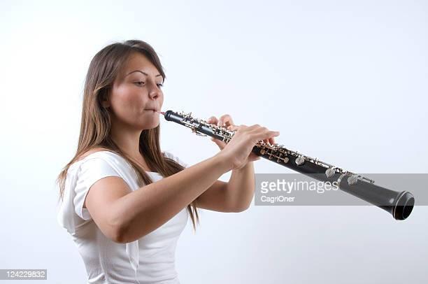 wunderschöne oboist - oboe stock-fotos und bilder