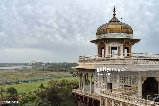 beautiful of architecture Mughal empire Taj Mahal in Agra  with yamuna river view from agra fort (India) landmark and Unesco world heritage site