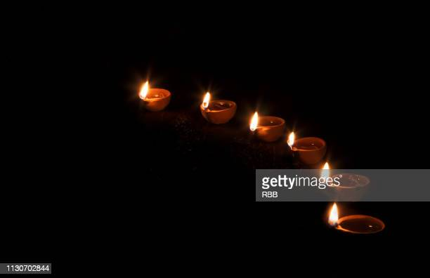 beautiful oil lamps - diya oil lamp stock pictures, royalty-free photos & images