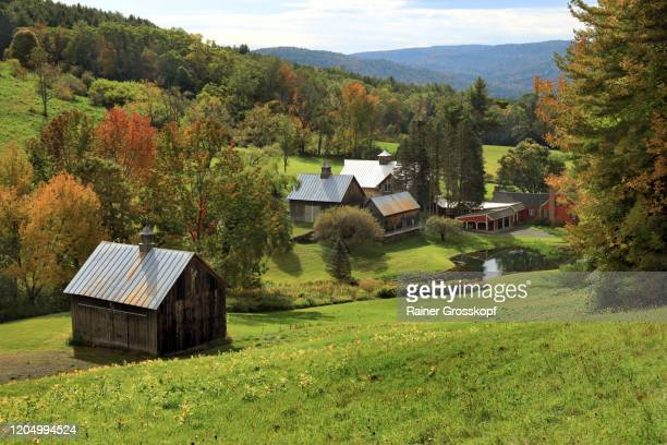 a beautiful old farm with big barns and a farmhouse, tucked away in a secluded valley in vermont - rainer grosskopf stock pictures, royalty-free photos & images