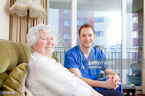 Beautiful old female patient with male nurse