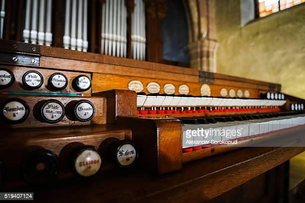 Beautiful old pipe organ in medieval cathedral, Andlau, France