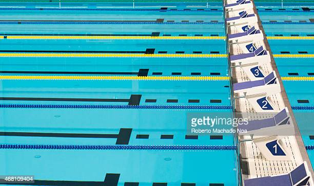 Beautiful Olympic sport competition swimming pool lanes in a clear transparent blue water facility.