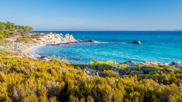 Beautiful Orange beach on the east coast of Sithonia peninsula, Halkidiki, Aegean sea, Greece.