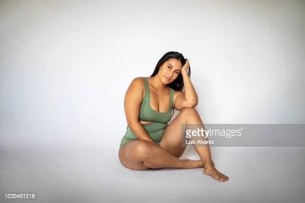 beautiful oversize woman in lingerie sitting on floor - knickers stock pictures, royalty-free photos & images